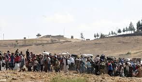 Decenas de miles de kurdos cruzan la frontera turca